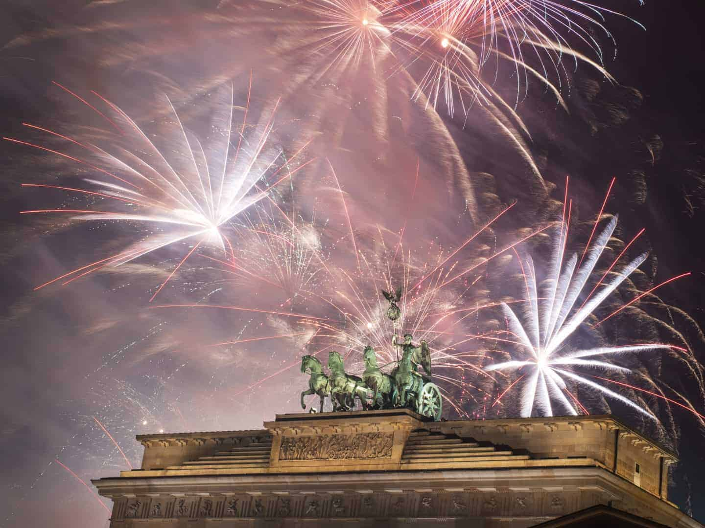 Fireworks over the Brandenburg Gate in Berlin, Germany, during New Year concert and celebrations.